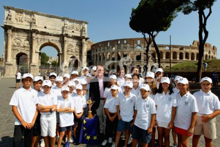 ROME, ITALY - SEPTEMBER 13:  Ryder Cup Director Richard Hills and the children of Marco Simone golf club pose with the Ryder Cup Trophy during the Ryder Cup Trophy Tour event on September 13, 2016 in Rome, Italy.The Ryder Cup Trophy Tour will visit several locations across Europe over the coming months to promote the 2016 Ryder Cup which will be held at Hazeltine National Golf Club in Minnesota, from September 30th  (Photo by Paolo Bruno/Getty Images for Ryder Cup Trophy Tour)